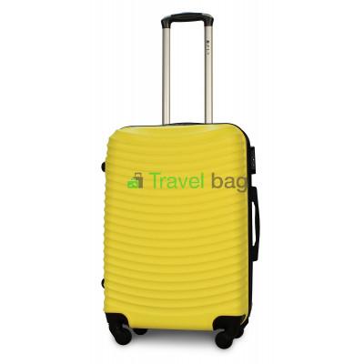 Чемодан пластиковый FLY 1053 средний желтый 65 см